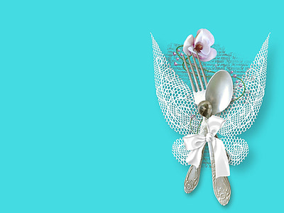 spoon and fork with white ribbon