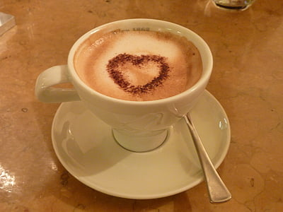 white ceramic coffee with heart decor