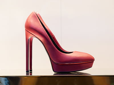pair of red leather platform stilettos on brown surface