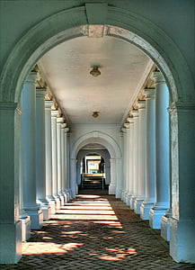 landscape photo of straight pathway with columns