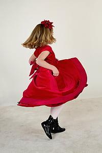 girl wearing red cap-sleeved midi dress