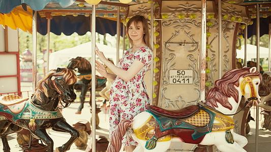 woman standing on carousel