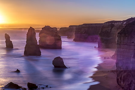 landscape photography of rock formation near the body of water