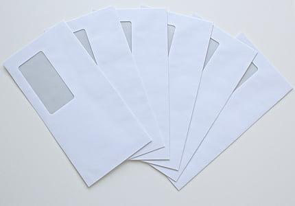 six white windowed envelopes