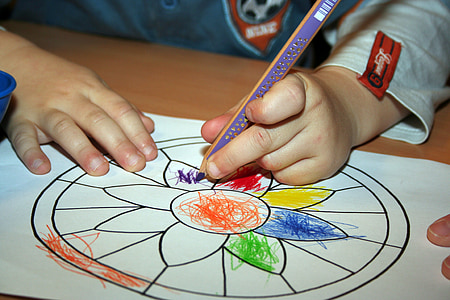 toddler coloring the flower