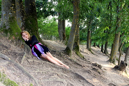 woman in black long-sleeved shirt sleeping near trees