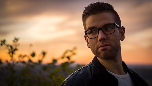 photo of man wearing black frame eyeglasses