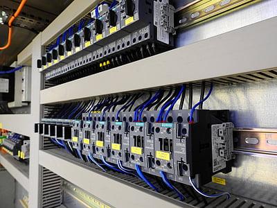 black contactors line on wall