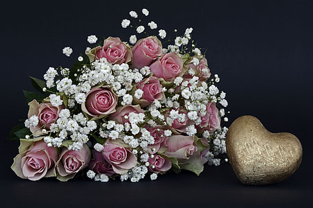 pink rose flowers and white petaled flowers