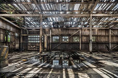 puddle under brown building skeleton