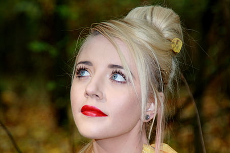 blonde haired woman in red lipstick