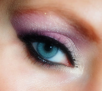 closeup photo of woman with purple and silver eyeshadow