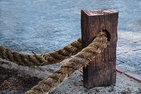 brown wooden rack with rope at daytime