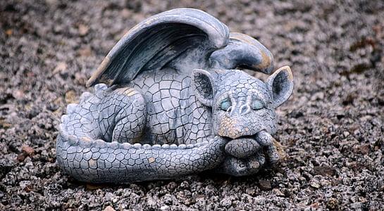 selective focus photography of gray dragon