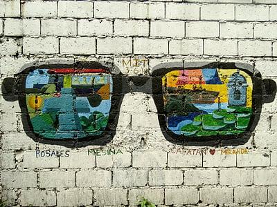 black framed multicolored sunglasses painting