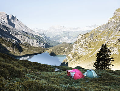 two dome tents on grass mountain