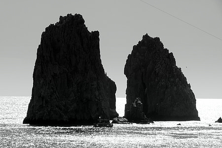 two rock formations in ocean