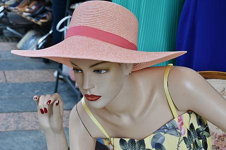 mannequin wearing pink hat