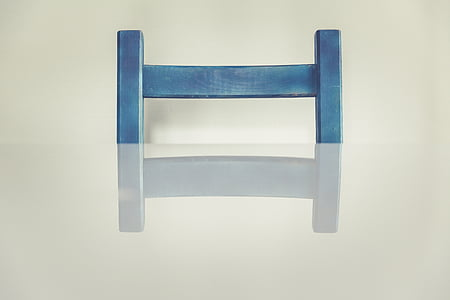 blue chair in front of table