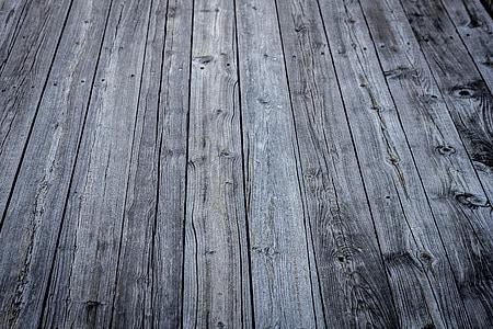 closeup photo of gray parquet floor