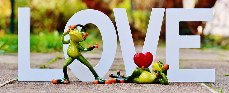 two frogs in front of love freestanding letter