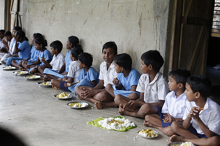children's eating while sitting on floor during daytime