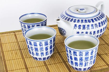 white-and-blue ceramic tea set