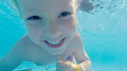 boy posing smile underwater