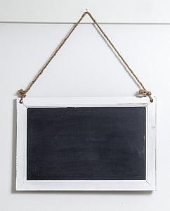 rectangular white framed blackboard