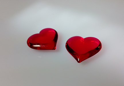 photo of two red heart gemstones