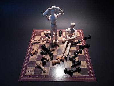two puppets on chess board