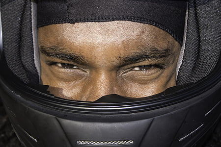 person wearing black helmet close-up photo