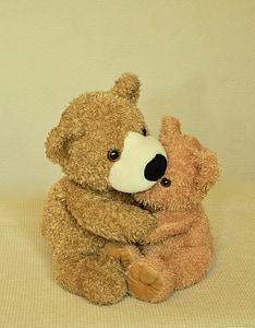 two brown bear plush toys