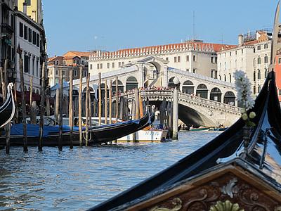black boat near bridge during daytime