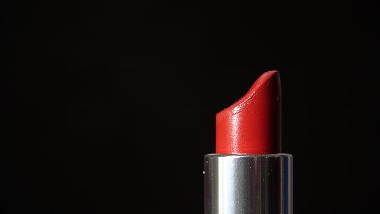 red lipstick in black background