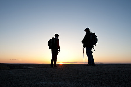 silhouette photo of two man
