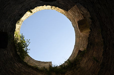 bottom-view of ruined tower during daytime