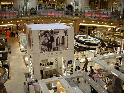 view of Burberry store with lots of people passing by