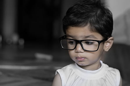 baby wearing eyeglasses
