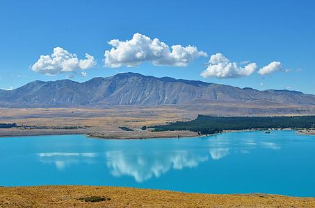 lake and mountain horizon during day time
