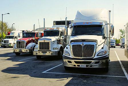 four semi trailer trucks