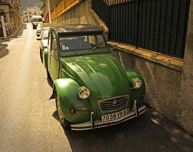 classic green Citroen car parks near concrete wall