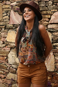 woman wearing brown and multicolored sleeveless top and brown bottoms