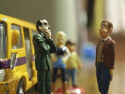 man in green top in front man in brown top figurines