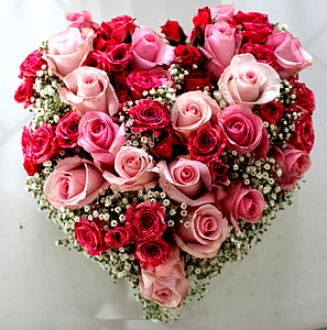 heart-shaped pink and red roses flower arrangement