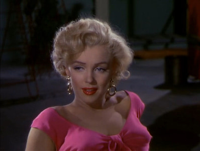 Marilyn Monroe with pink cap-sleeved shirt