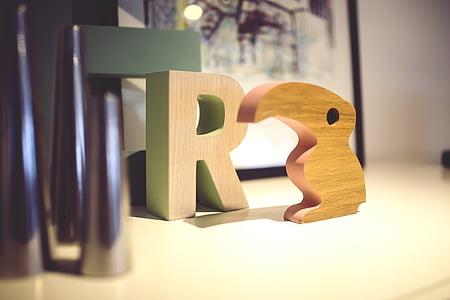 R signage on white desk