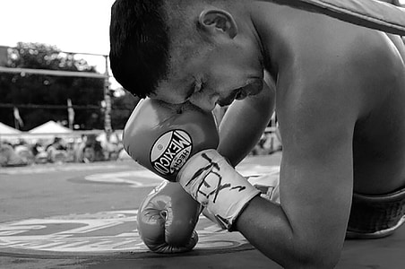 grayscale photo of male boxer on boxing ring
