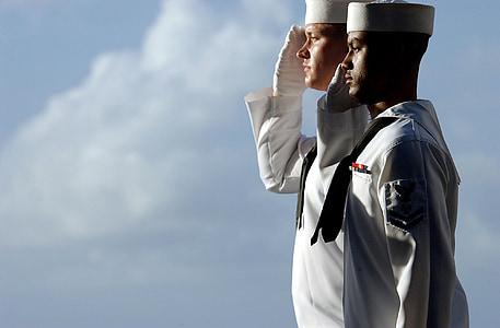 two men wearing white sailing suits