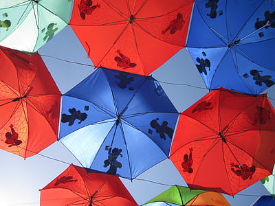 assorted-color umbrellas under the clear sky during daytime